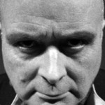 John Burns as Aleister Crowley